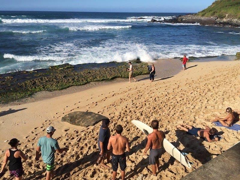 surfers at hookipa beach park